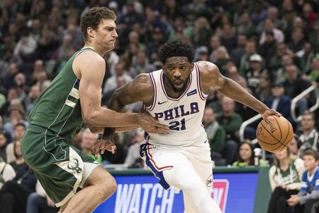 Sixers beat Bucks to clinch play-off spot