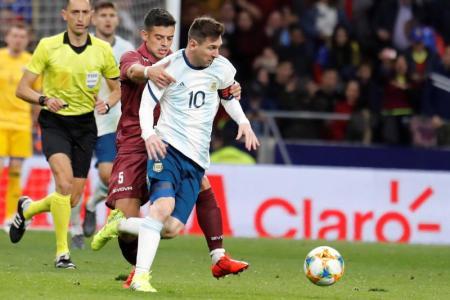 Messi injured on return to international duty