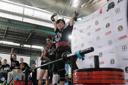 Mum muscles her way to top of strongman lifting contest