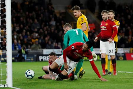 Hungry Wolves devour 10-man Manchester United