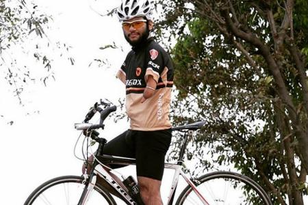 Disabled cyclist leads 270km ride from Malacca to Singapore