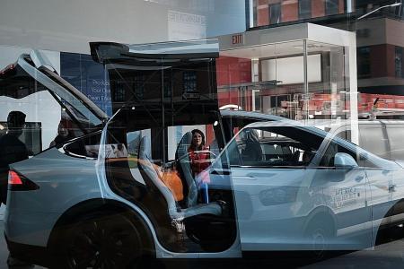 Tesla vehicles on display in a showroom in Manhattan.