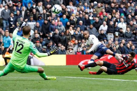 Moura bags hat-trick as Spurs sink Huddersfield 4-0