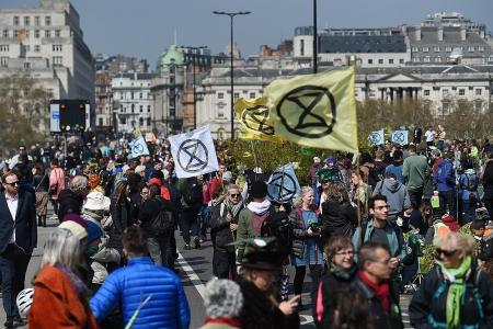 Thousands of environmental activists paralyse parts of London