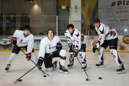 National ice hockey players take their schoolwork along during tourney