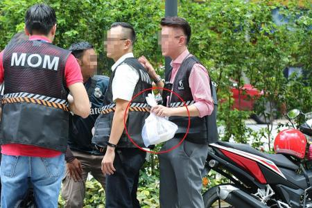 Two Malaysians arrested as MOM cracks down on illegal delivery riders
