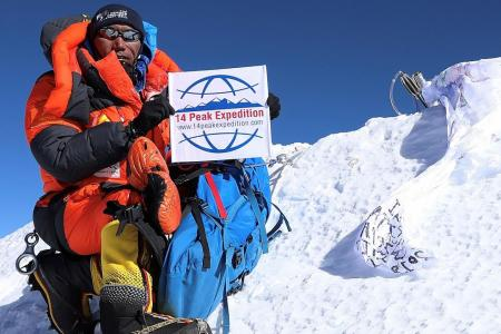 Sherpa celebrates world-record Everest climbs... by doing it again
