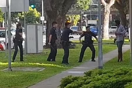 Man tasered after charging at police