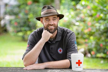 He journeys across the world without flying for the Red Cross