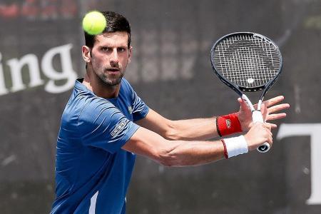 No grass courts, no problem for Novak Djokovic