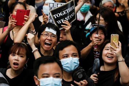 HK protestors go on the march to woo Chinese visitors