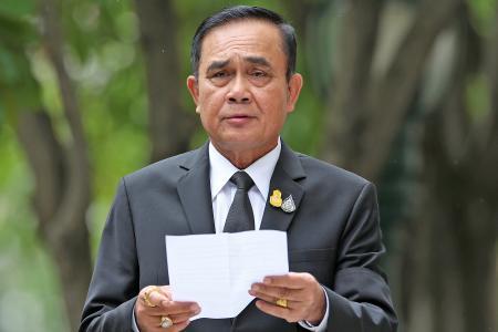 Thai leader orders end to military rule but keeps some junta powers