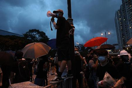 Protesters and police clash again at HK rally