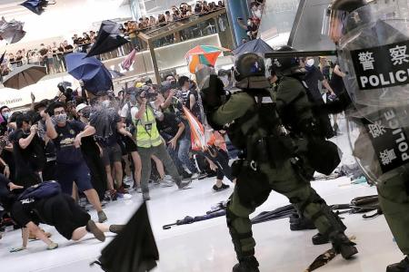 HK leader calls protesters who clashed with cops rioters