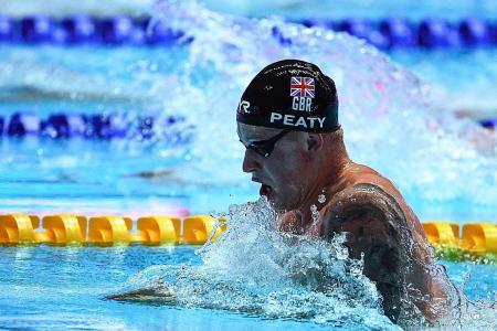 British swimmer Adam Peaty turns up the heat with treble feat