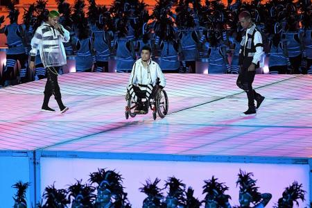 Wheelchair-bound rapper wants people with disabilities to 'stand up'