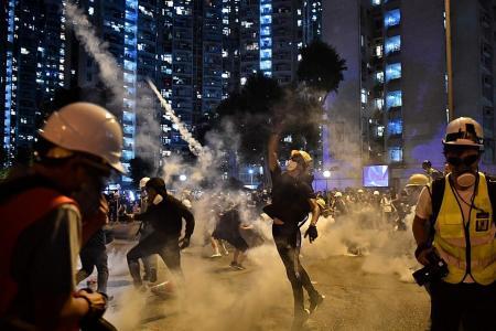 HK cops fire tear gas, rubber bullets as strikes paralyse city