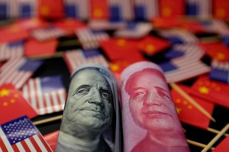 China lets yuan fall as trade war escalates