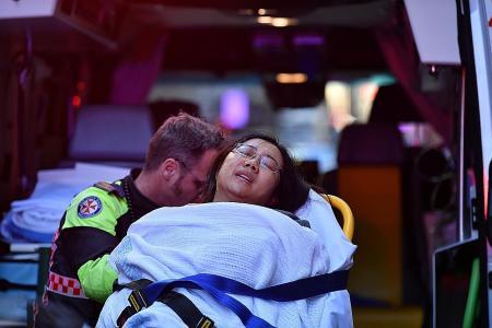 Bystanders pin down Sydney stabber, ending his rampage