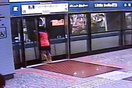 Woman gets stuck between MRT train and platform doors