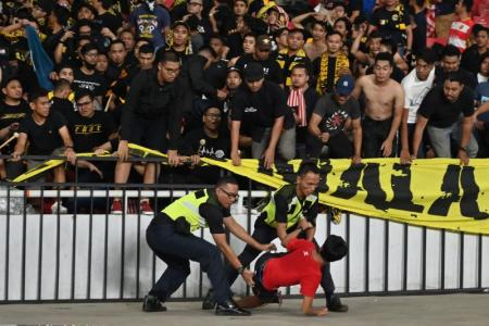 Malaysia to file complaint to Fifa over crowd trouble in Indonesia game
