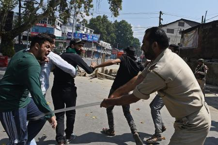 India imposes curfews in Kashmir after procession clashes