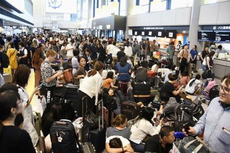 17,000 stranded at airport as typhoon hits Tokyo