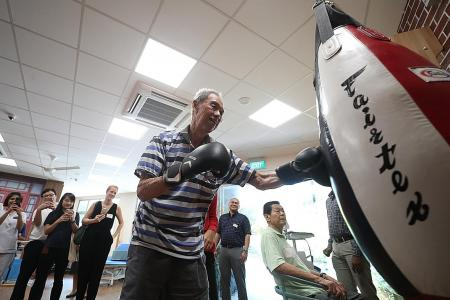 Seniors stay motivated for rehab through boxing, football