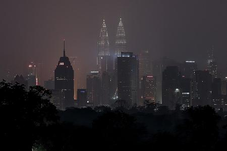 M'sia may compel firms to put out fires abroad