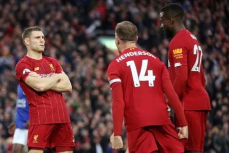 Salah injury overshadows late win for Liverpool