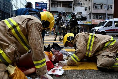 Petrol bombs, tear gas rock HK; many arrested for defying mask ban