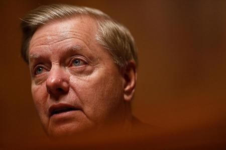 Top Trump ally Graham calls for reversal of Syria border pullback