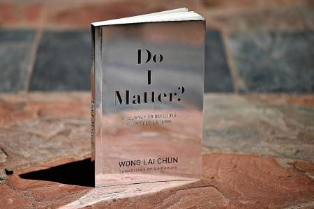 SOS senior assistant director pens book on self-esteem