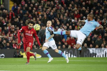 Liverpool go eight points clear with 3-1 win over Man City
