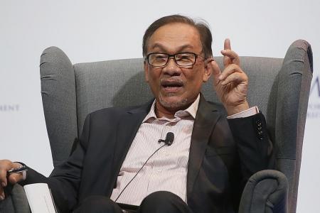 Anwar, Mahathir meet to discuss transition