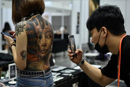Malaysia probes tattoo expo over nudity