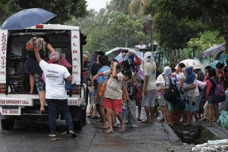 Thousands flee as typhoon heads towards Philippines