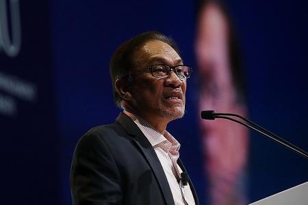 Anwar denies ex-aide's allegations of sexual assault