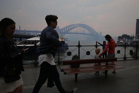 In Sydney, smoke gets in their eyes as fires rage