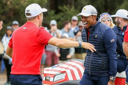 Playing captain Tiger Woods hugging teammate Justin Thomas (left) after the Americans' Presidents Cup victory.
