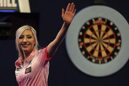 Fallon Sherrock is first woman to beat a man at World Darts C'ship