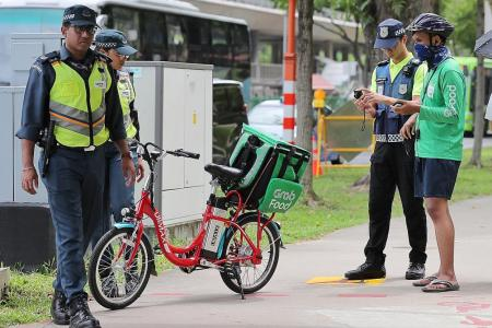 GrabFood to still use e-scooters, will ban those caught on footpaths