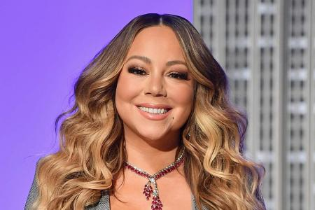 Mariah Carey first artist to score No.1 hit in four different decades