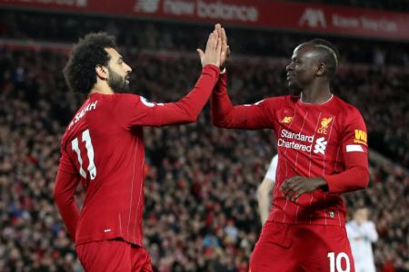 Liverpool extend unbeaten EPL run to a year with 2-0 win over Blades