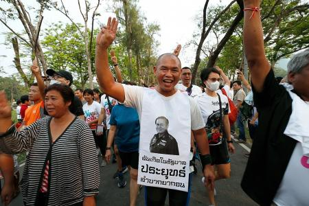 Thousands join Thai anti-government run while rival camp pushes back