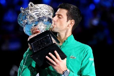 Dizzy, dehydrated Djokovic downs Thiem to win eighth Australian Open