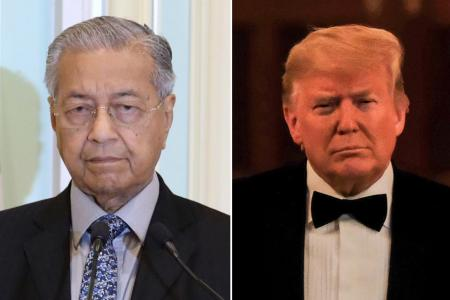 Mahathir says he called for Trump's resignation to save US