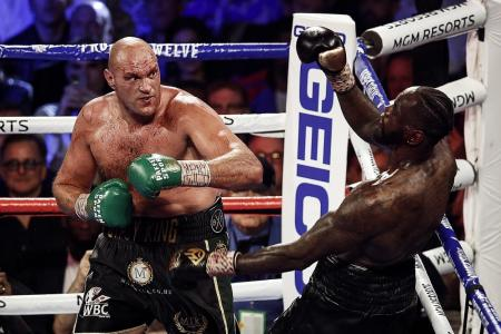 King Tyson subjects Deontay Wilder to fist of Fury