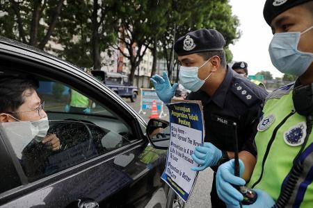 Malaysia reports record jump of 212 coronavirus cases