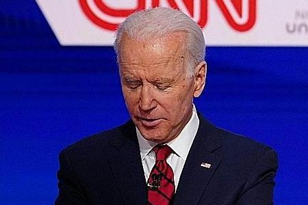 Biden battles for attention as coronavirus slows his momentum